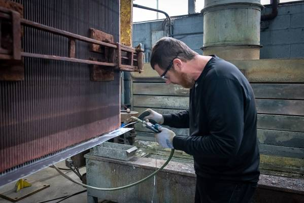 a man manufacturing an aftermarket heat exchange product