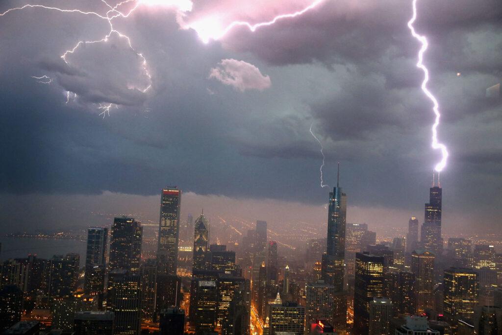 a city skyline with lightning striking