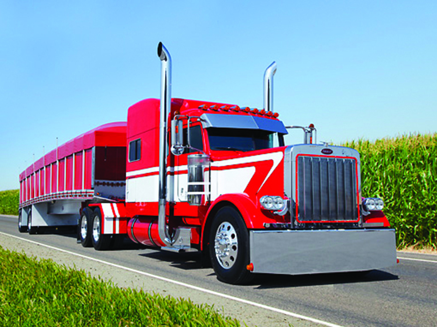 red semi truck with visible radiator