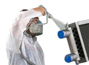 a man spraying a radiator with an anti-corrosive coating
