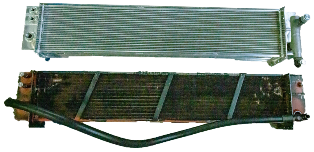 a new and an old aluminum oil cooler side-by-side