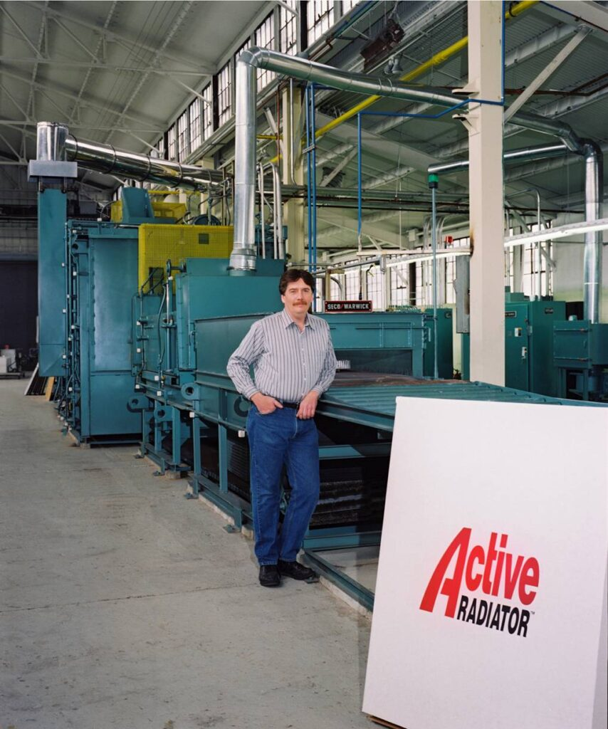 Marty Newell, founder of Active Radiator, next to his shop equipment